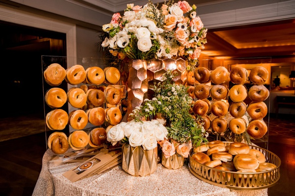 wedding reception rose gold flower arrangement bagel bar with to go take home bags wedding favors