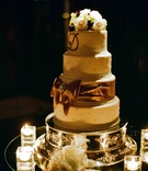 Four layer wedding cake dotted with pearls