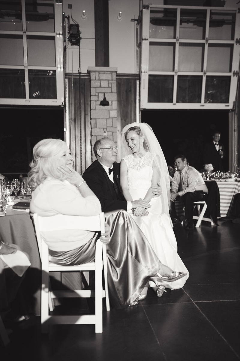 bride sits with family at reception