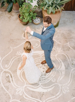 Welcome party rehearsal dinner destination wedding grey suit brown shoes bride in white dress lotus