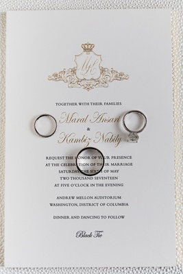 Black tie wedding invitation gold monogram crest with crown wedding rings on top
