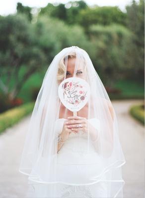 Bride in Carolina Herrera veil with silk trim