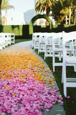 aisle covered with flower petals pink and yellow flowers