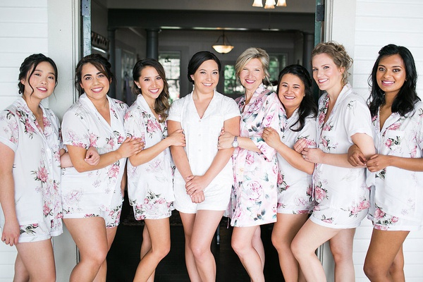 wedding beauty pajamas flower print and bride in white with mom bridesmaids