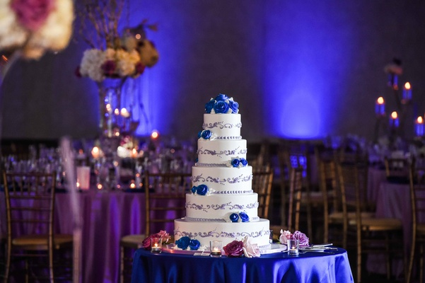 Blue And Purple Lighting Five Tier Wedding Cake Featured Frosted Blues Flowers With Grayish Lavender Detail