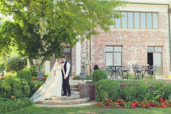 Bride and groom in front of New Jersey golf club