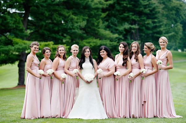 Pale pink Twobirds bridesmaid dresses with Vera Wang bride