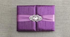 Violet gatefold wedding invitation box with light purple ribbon, crystal brooch