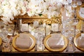 Mirror wedding reception table with gold rim charger plates, gold Baroque box white flowers