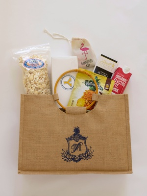 burlap welcome bag filled with popcorn with stamp of monogram  hangover kit electrolyte drink