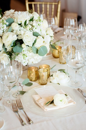 white floral centerpiece, trio of gold votives, bloom on napkins,
