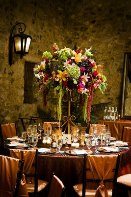 Candelabra flower centerpiece on copper reception table