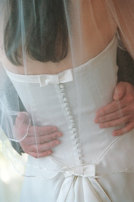 Back of bride's gown with buttons and bow detail