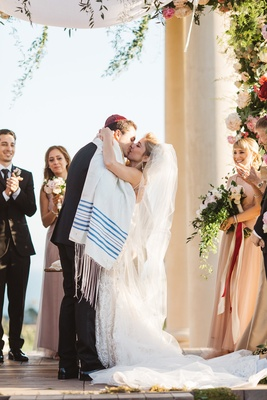 couple shares first kiss california venue jewish garb kippah tallit veil pelican hill wedding