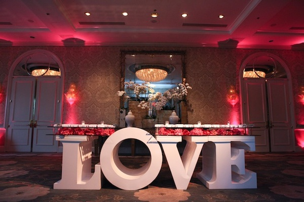 Large letter L-O-V-E table base with seating cards
