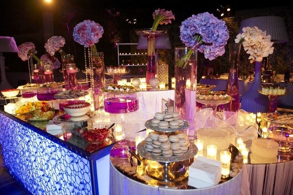 Spread of desserts and macarons at purple wedding