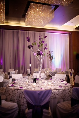 Fluted vases filled with silver branches and flowers