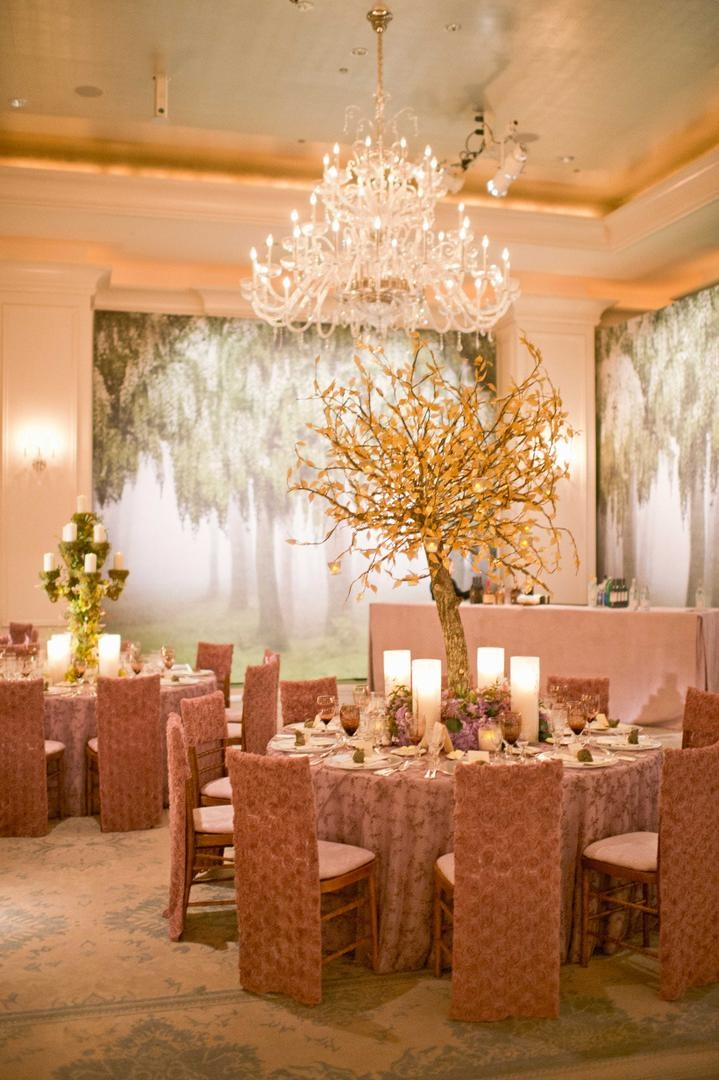Tree mural on ballroom wedding walls and elm centerpiece
