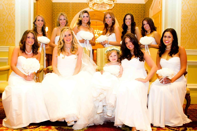 Bride with flower girl and bridesmaids in white gowns