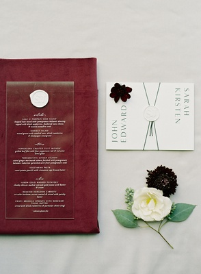 wedding paper goods eescort cards envelope and acrylic menu with white wax seal burgundy napkin