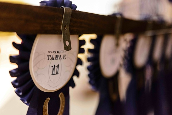 Table numbers on back of horse show ribbons