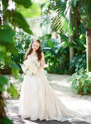 bride gown tropical location bouquet white cream beading sweetheart neckline train florida