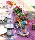 glass dome over geode table number, purple aisle runner on wood table