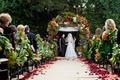 Bride and groom at end of outdoor wedding aisle