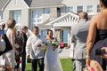 Bride walking down grass aisle with father of bride