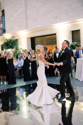 wedding reception first dance mirror dance floor bride in pronovias gown bustle for dancing updo