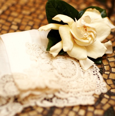 White handkerchief with ivory gardenias boutonniere