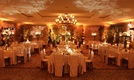 Luxury ballroom wedding reception with topiaries