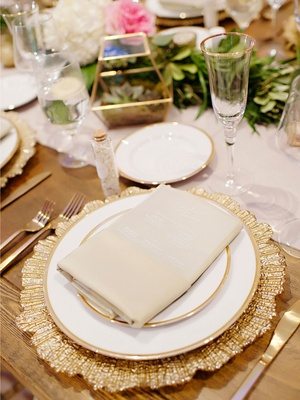 Wedding reception wood table linen runner gold charger plate terrarium sprinkles champagne flute