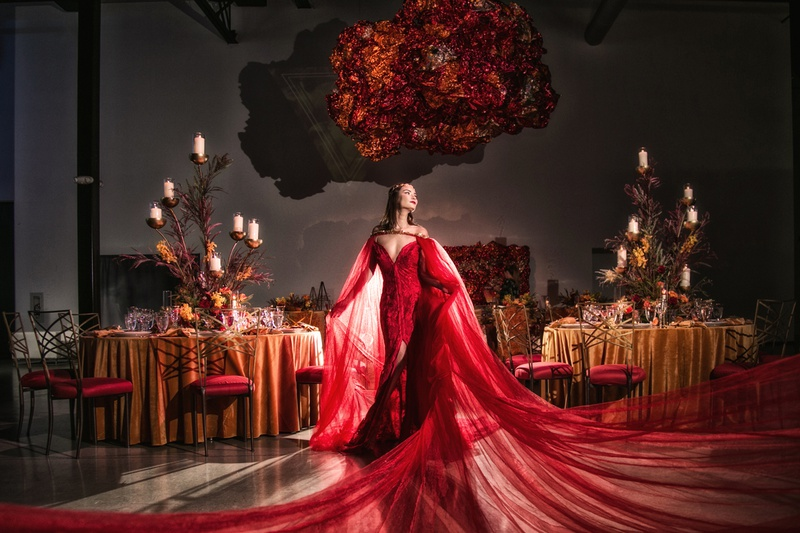 6b0100030 wedding styled shoot with model wearing red wedding dress with long train