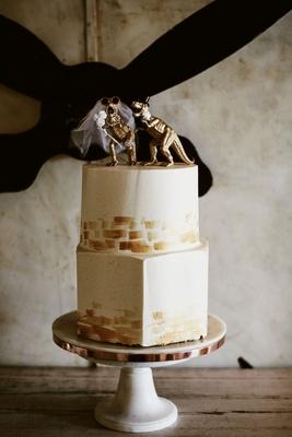 wedding reception hexagon bottom layer round top layer gold dinosaur bride and groom cake topper
