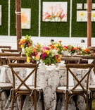 Outdoor wedding wood chairs rustic bright centerpiece yellow pink green orange flowers lacy linen