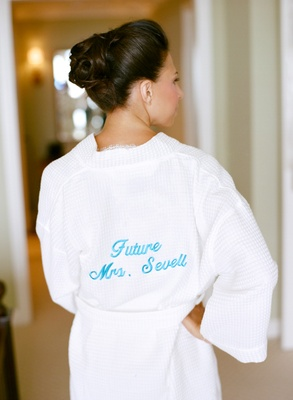 Bride wearing plush robe with blue personalization