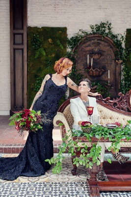 Bride in a black R-Mine Bespoke dress with appliques, chapel train with bride in white blazer