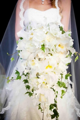 Catteleya orchid bouquet with leaves and stephanotis
