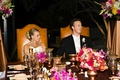 Bride and groom sit at head of reception table