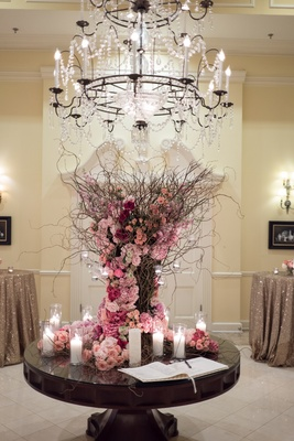 guest book display wild sticks arrangement with roses in shades of pink