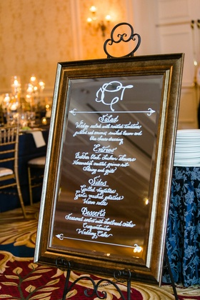 Wedding reception menu in calligraphy on mirror