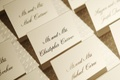 White and black lettering seating card