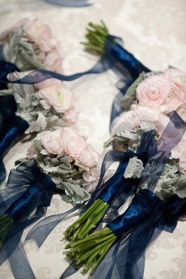 Pink ranunculus tied with navy blue ribbon