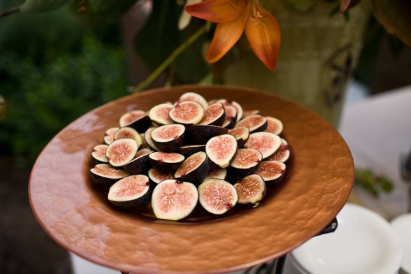 brown bowl of sliced figs
