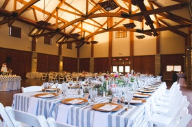 lodge style room with table topped with gray striped tablecloth