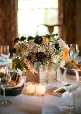 Ranch wedding centerpiece with pink roses, dahlias, peach peonies, greenery, dark berries