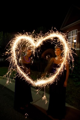 Bridesmaids make heart shape with sparklers
