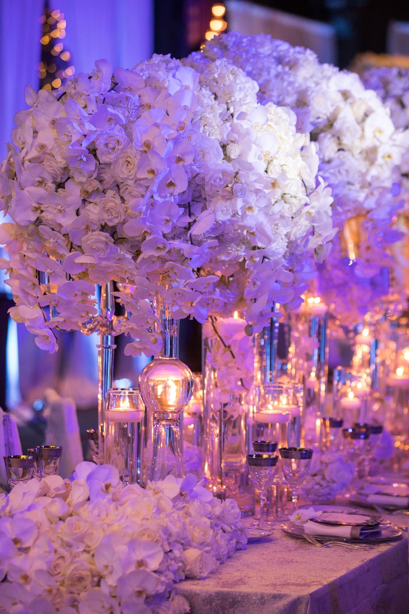 Wedding reception flower runner on table end candles white rose orchid centerpieces
