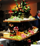 Tiered fruit display with basket topper